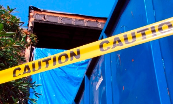 Fire damaged house with caution tape