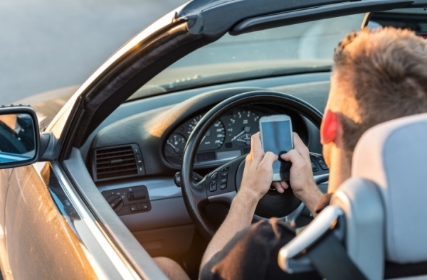 Young male texting and driving