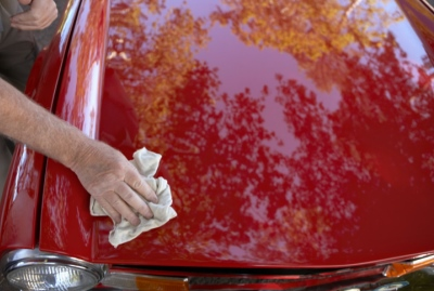 Man Polishing the Hood of His Car