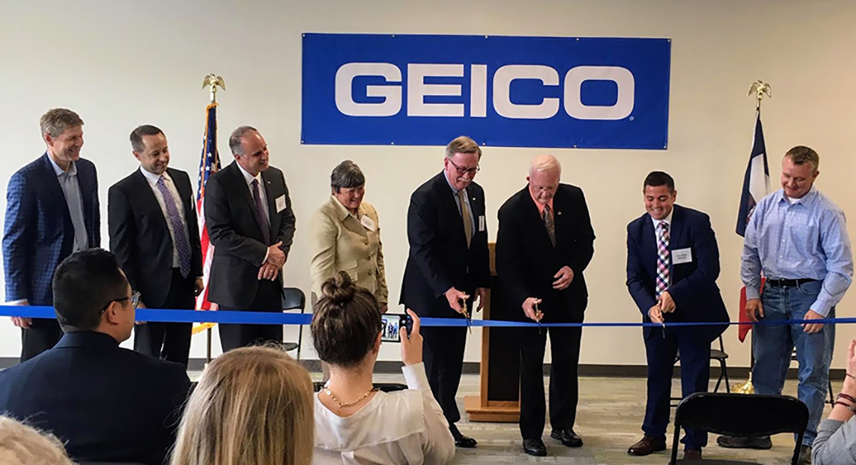 GEICO executives and North Liberty officials cut the ribbon on GEICO's new Iowa office