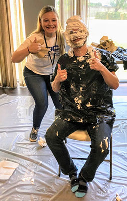 "Macon associates ""pie"" their managers for a good cause"