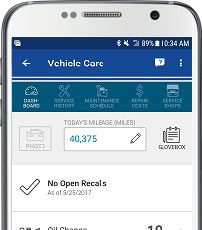 A smartphone using GEICO Mobile's app for vehicle care