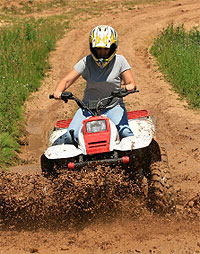 ATV rider on a dirt path