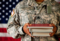 Military member holding textbooks