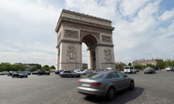 Cars driving by the Arc de Triomphe in France