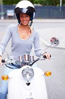 Woman on scooter with helmet