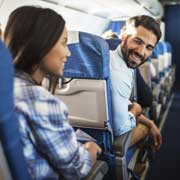man and woman talking on airplane