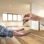 person giving set of keys to open hand