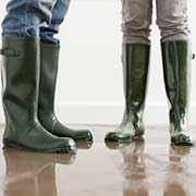 people wearing rubber boots standing in water