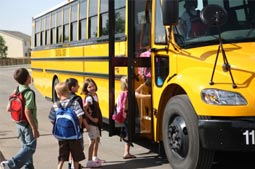 children entering schoolbus